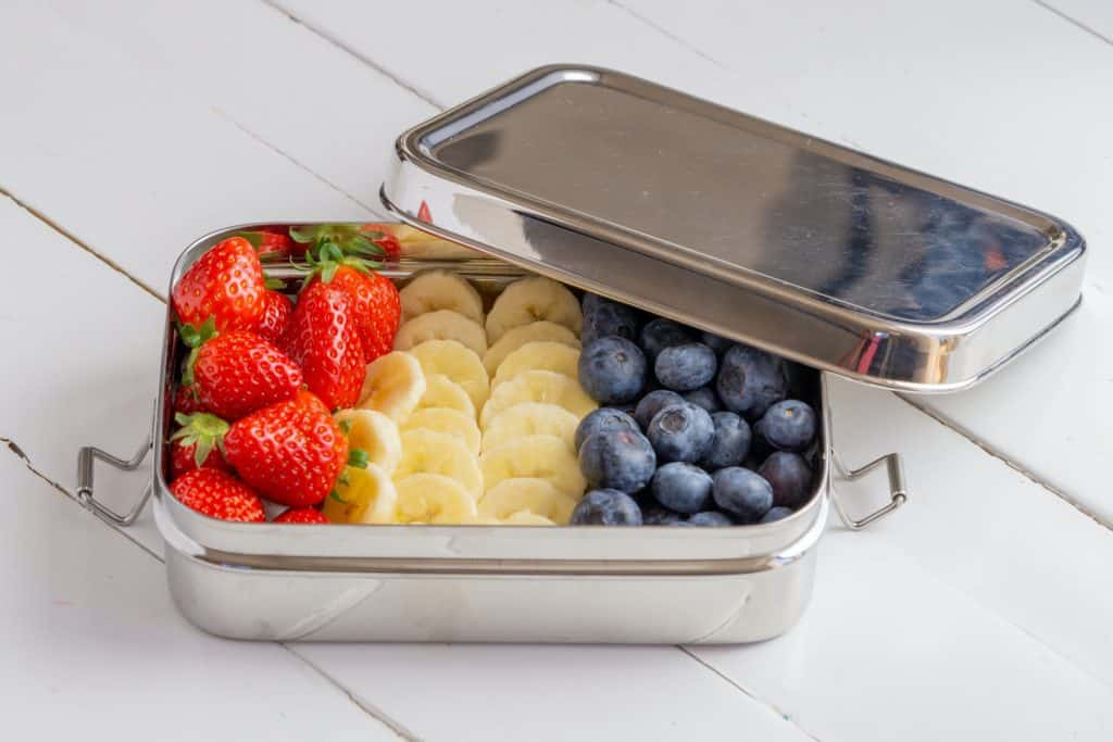 picture of stainless steel lunch box with fruit inside